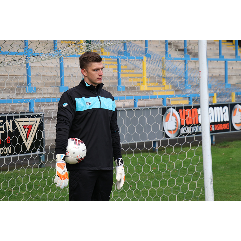 Nick Pope of Burnley FC wearing his Sells Aqua Rain Jacket