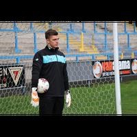 Nick Pope of Burnley FC wearing his Sells Aqua Rain Jacket